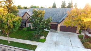 birds eye view of front home exterior, driveway on right