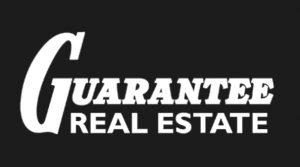 Guarantee Real Estate Business Logo