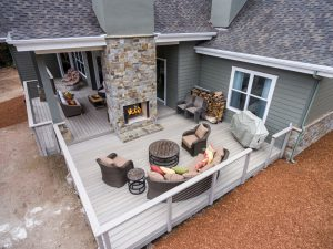 furnished backyard deck and fireplace