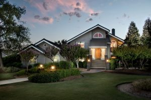 a front yard angle of a multistory home at twilight