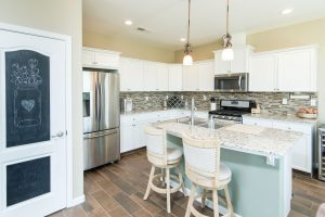 kitchen with tile backsplash and granite counter top island