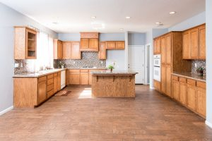 kitchen with tile backsplash and wood flooring