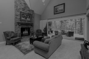 a living room with a digitally rendered fireplace