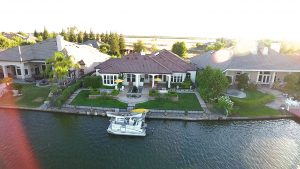 luxury listing property with a private dock connected to lakeside home