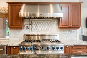 detailed image of a brushed metal oven range