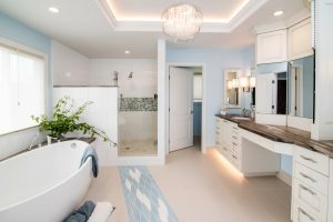 a spacious bathroom with a wooden counter-top, and LED lighting