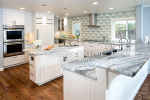 clean kitchen with granite counter tops